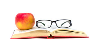 Book, glasses and apple on a white background Royalty Free Stock Photography