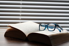Book glasses blinds A Stock Photography