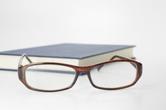 Book and Glasses - Conceptual Stock Photos
