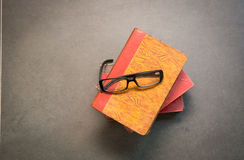 Book with glasses on the floor Royalty Free Stock Image