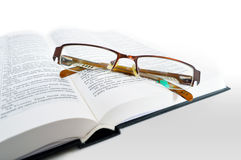 Book with glasses Stock Photos