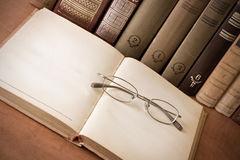 Book and glasses in the library Stock Image