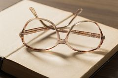 Book and Glasses royalty free stock photography