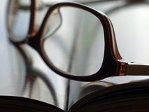Book with glasses Stock Images