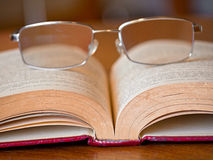 Book with glasses Royalty Free Stock Image