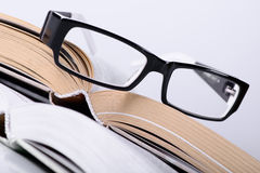 Book with a glasses Stock Images