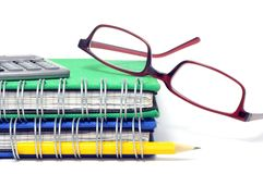 Book, glasses and pen Stock Photography
