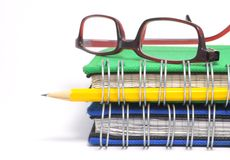 Book, glasses and pen Royalty Free Stock Photos