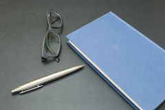 Book with glasses and a pen Royalty Free Stock Photo