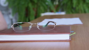 Book and Glasses stock video footage