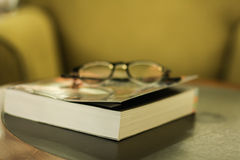 Book and glasses. The book on the table have so many pages Royalty Free Stock Photography
