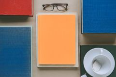 Book glasses and tea on the desk with study and education concep Stock Images
