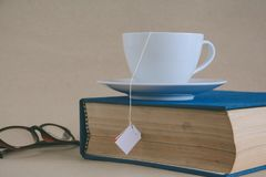 Book glasses and tea on the desk with study and education concep Royalty Free Stock Photos