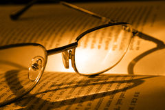 Book and Glasses. Vintage style Stock Images