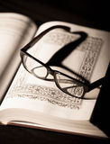 Book and Glasses. Vintage style Stock Image
