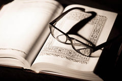 Book and Glasses. Vintage style Royalty Free Stock Photo