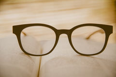 Book and Glasses. Vintage style Stock Photography