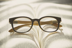 Book and Glasses. Vintage style royalty free stock photography