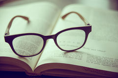 Book and Glasses. Vintage style royalty free stock images