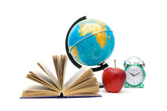 Book, globe, apple and an alarm clock on a white background Royalty Free Stock Photos