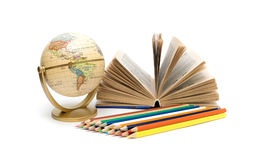 Book, globe and pencils of different colors on a white backgroun Royalty Free Stock Photo