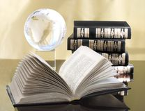 Book with globe still life ( reading series) Royalty Free Stock Images