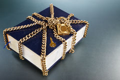Book with golden chain and lock Stock Image
