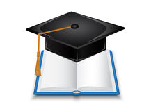 Book and graduate cap Stock Image