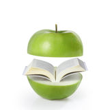 Book green on apple Royalty Free Stock Image