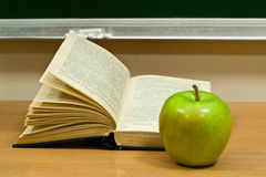 Book and green apple Stock Photo