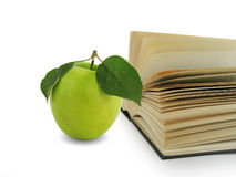 Book and green apple Royalty Free Stock Photos