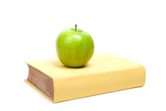 Book and green apple Royalty Free Stock Images