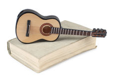 Book and guitar Stock Photos