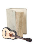 Book and guitar Royalty Free Stock Image