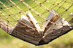 Book in a hammock nobody Royalty Free Stock Photos