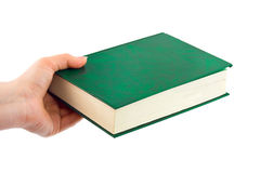 Book in hand Stock Images