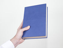 Book in hand Stock Photos