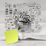 Book of hand drawn business strategy. With 3d metal brain on crumpled paper background as concept Royalty Free Stock Photo