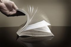 Book and Hand Flipping Pages Information Reading. Book for reading and hand flipping pages looking at information Royalty Free Stock Photos