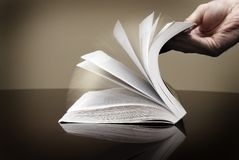 Book and Hand Flipping Pages Information Reading. Book for reading and hand flipping pages looking at information Royalty Free Stock Photo