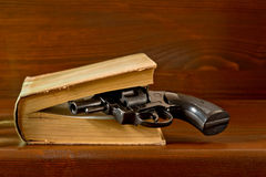 Book with handgun Stock Photo