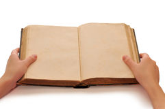 The book in hands. The old book which is in female hands Royalty Free Stock Photo