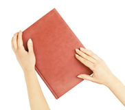 Book in the hands of a girl Royalty Free Stock Image