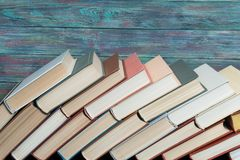 Book hardback on wooden table. Book stacking open book hardback books on wooden table. copy space stock photography