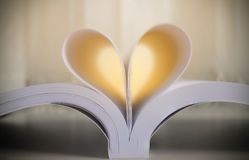 Book with hart shape made of pages, vintage effect style picture. S royalty free stock photo