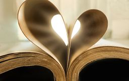 Book with hart shape made of pages, vintage effect style picture. S stock image