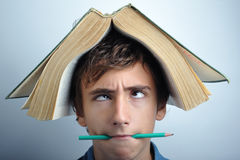 Book on head Royalty Free Stock Photos