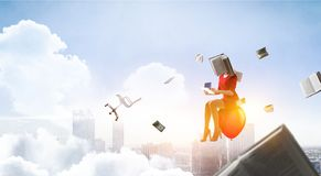 Book headed woman. Business efficiency concept. Mixed media stock photo