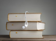Book with headphones Royalty Free Stock Images