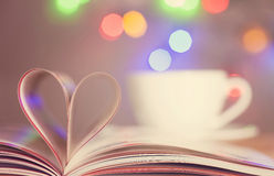 Book with heart. Book with pages folded into a heart shape Stock Photography